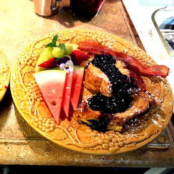 Orange Stuffed French Toast with a Orange-Blueberry Sauce & Bacon